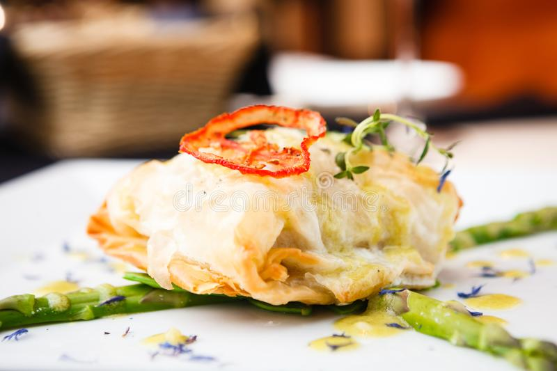 Chilean sea bass. Chilean sea-bass in papilliote on a plate royalty free stock photos