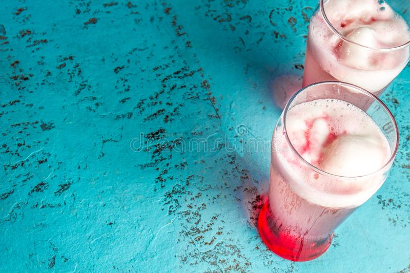 Chilean traditional alcoholic drink Terrremoto. with pineapple ice cream, liquor grenadine, pisco and white wine. Blue. Background royalty free stock images