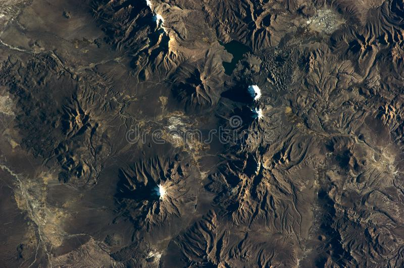 Chilean volcanos mountains relief Satellite view texture from earth above . Elements of this image furnished by NASA. royalty free stock photography