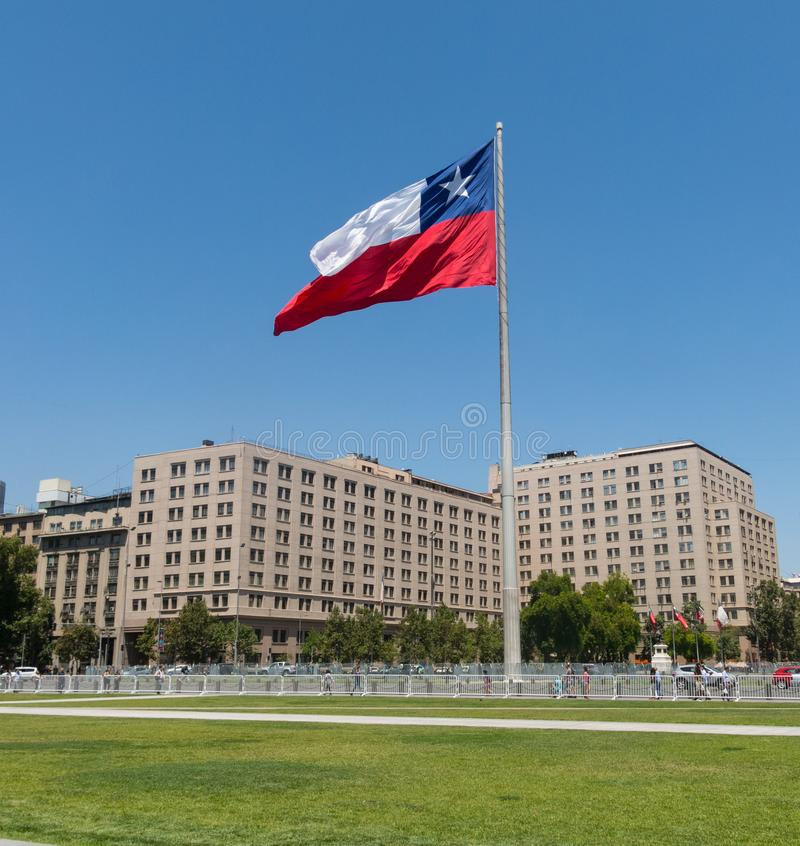 Chileans walking near the giant flag on Avenida La Alameda with the citizenship Square, in downtown Santiago de Chile. Chile royalty free stock photos
