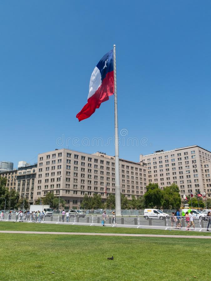 Chileans walking near the giant flag on Avenida La Alameda with stock photos