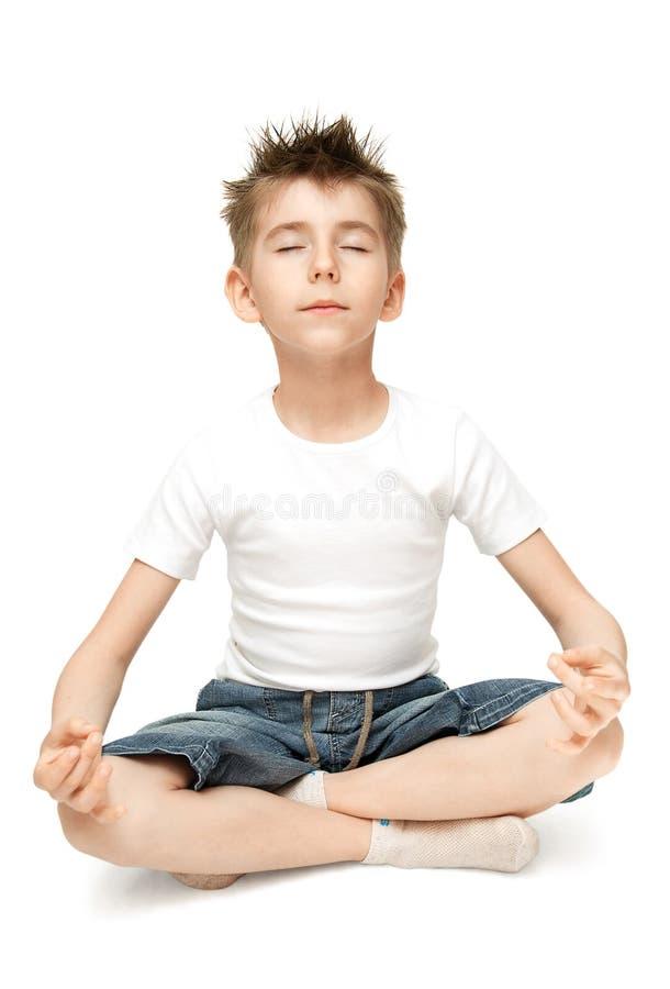 Chiled practicing yoga royalty free stock image