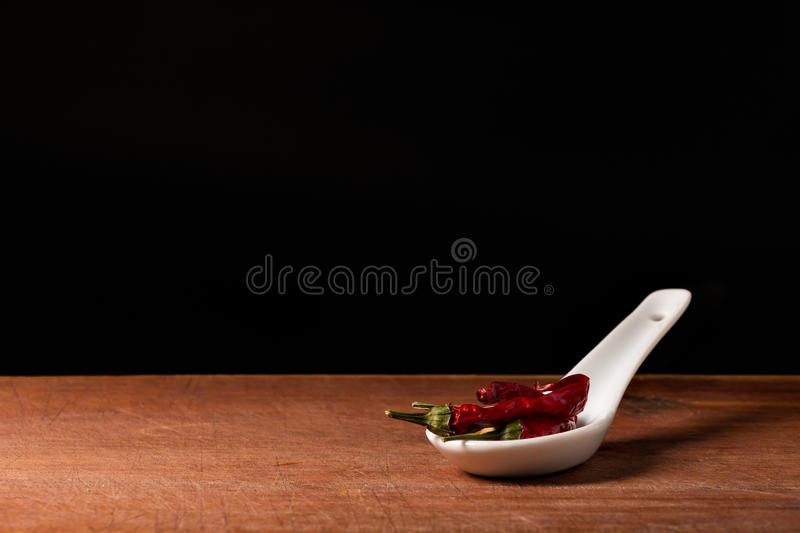 Chili (Capsicum) on a spoons stock photo