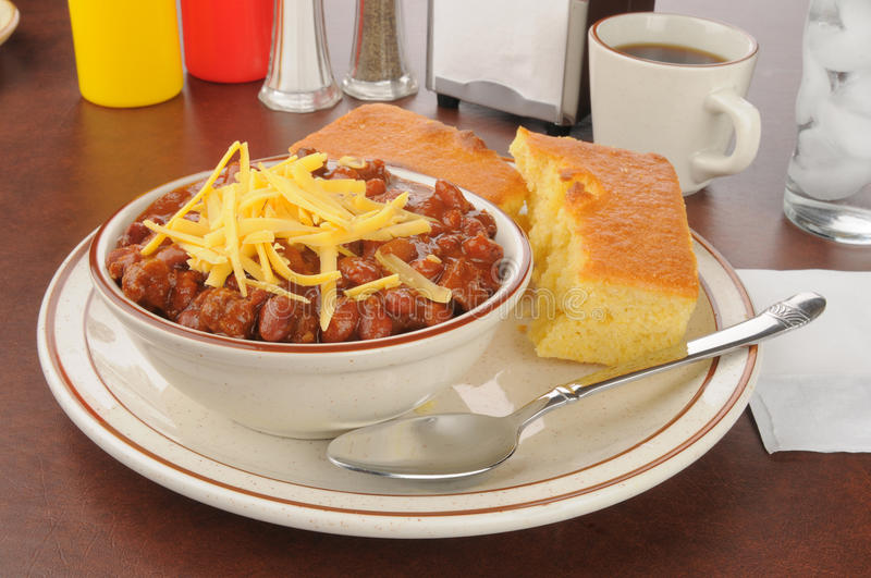 Chili with cheese and cornbread stock images