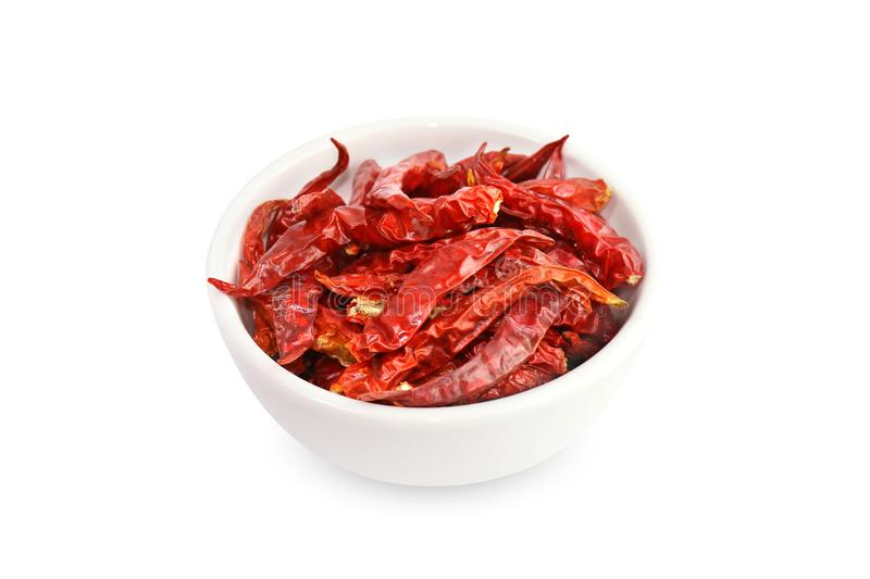 Chili, Chilli red Spicy hot flavor, Dried red chillies in a white cup top view on white background royalty free stock photo