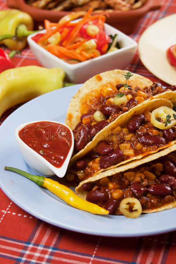 Chili con carne burrito in taco shell royalty free stock images