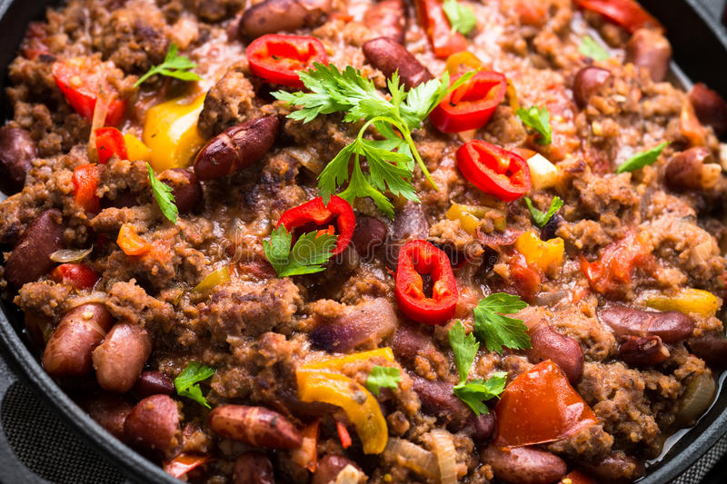Chili con carne. Traditional mexican food. Chili con carne in a cast iron pan. Traditional mexican food. Close up royalty free stock images