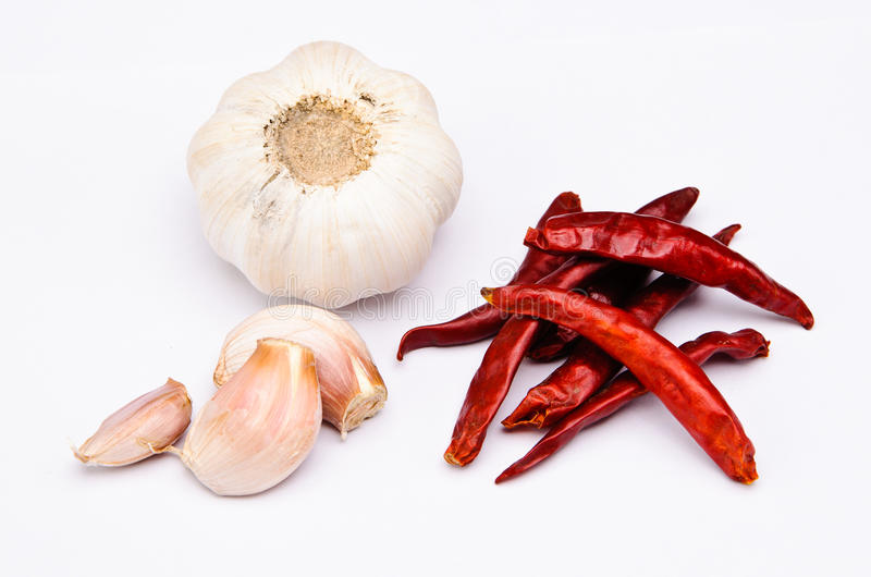 Chili fruit and garlic. On a white background royalty free stock photo