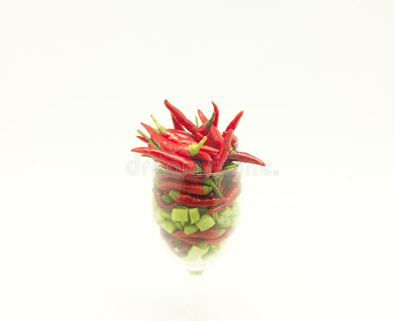 Chili in a glass royalty free stock photos
