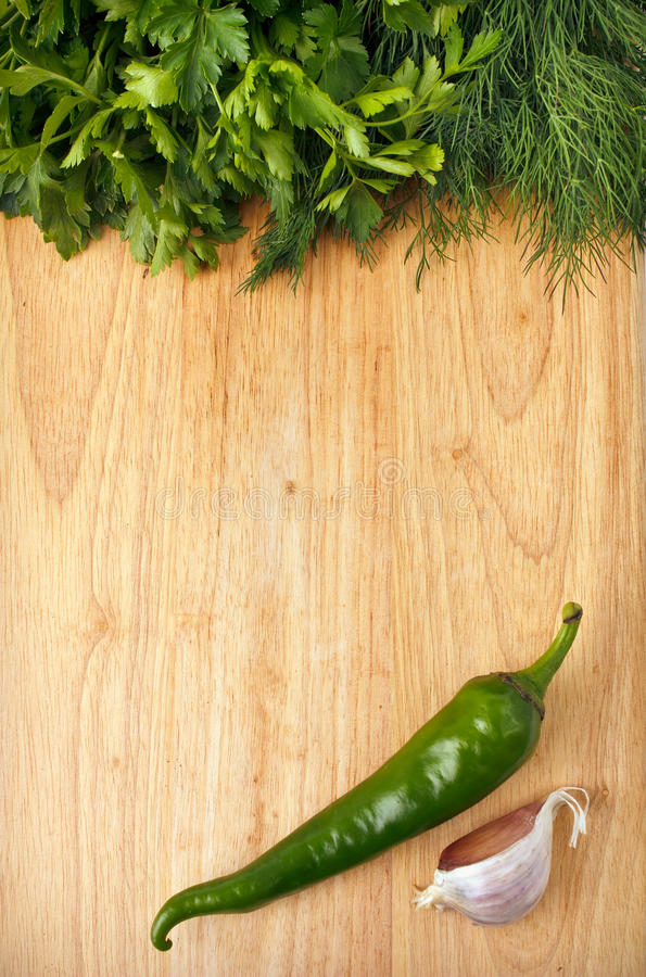 Download Chili, Parsley And Garlic On The Wooden Background Stock Photo - Image: 21561712