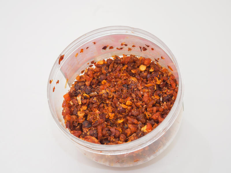 Chili Paste Dried in the Bowl. Chili Paste Dried in the Bowl on white background royalty free stock photos