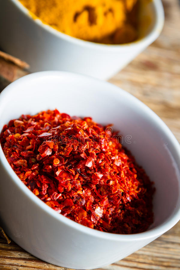 Chili pepper. A bowl with ground chili pepper flakes royalty free stock images