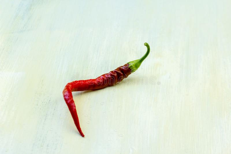 Red hot chili pepper on white background. The chili pepper from Nahuatl chīlli Nahuatl pronunciation: is the fruit of plants from the genus Capsicum, members stock photo