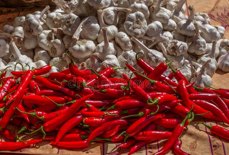 Chili peppers and garlic bulbs at a farmers` market in Switzerland - 1 stock photos
