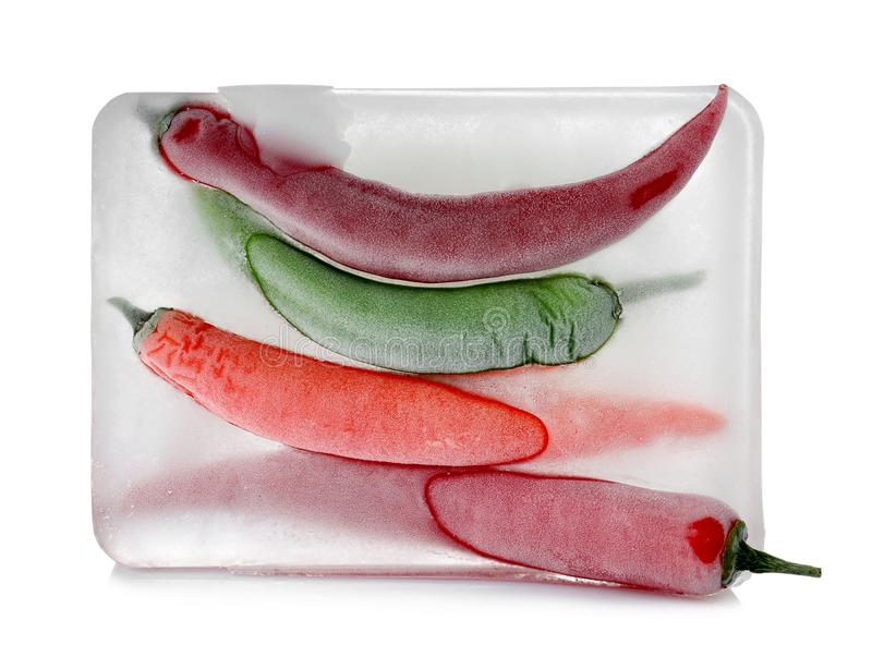 Chili peppers in ice cube on white backgroun. D. Frozen vegetables royalty free stock photos