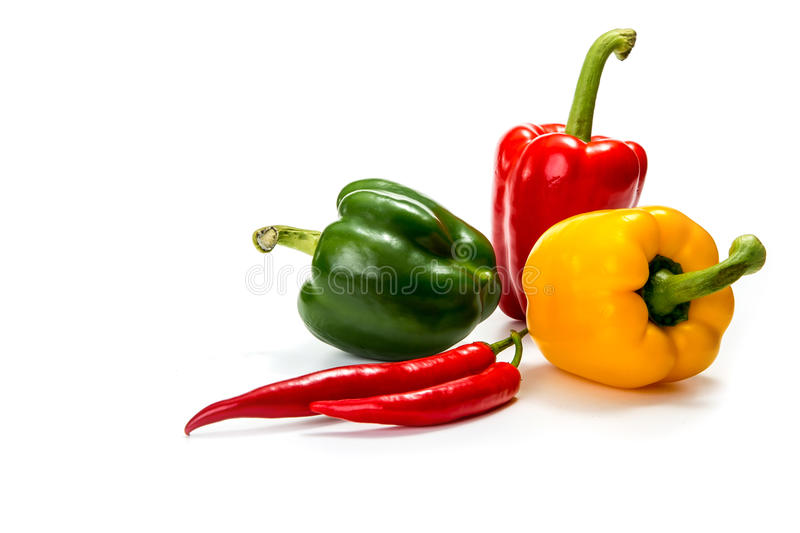Chili peppers and red, yellow and green bell pepper royalty free stock photography