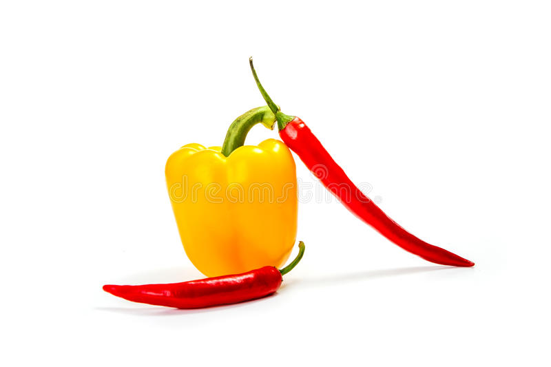 Chili peppers and red, yellow and green bell pepper royalty free stock photo