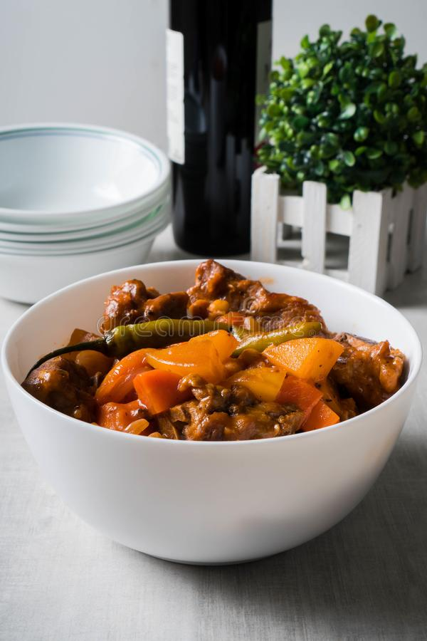Chili pork bones in tomato sauce with carrots and potatoes royalty free stock images