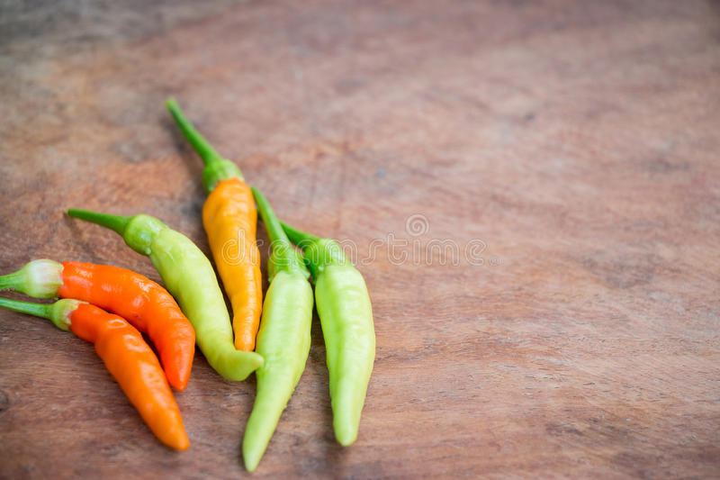 Chili on the wooden background, closeup chili. royalty free stock photo