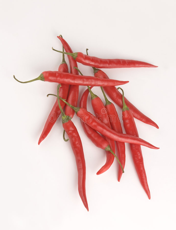 Chilies på vit bakgrund royaltyfri bild