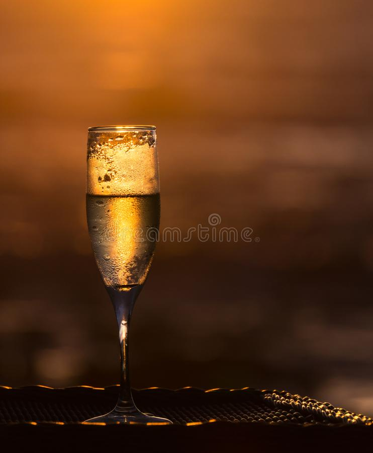 Chilled Glass of Champagne in Golden Light stock images