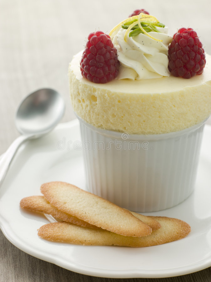 Download Chilled Lemon Souffle With Langue De Chat Biscuits Royalty Free Stock Images - Image: 5614599