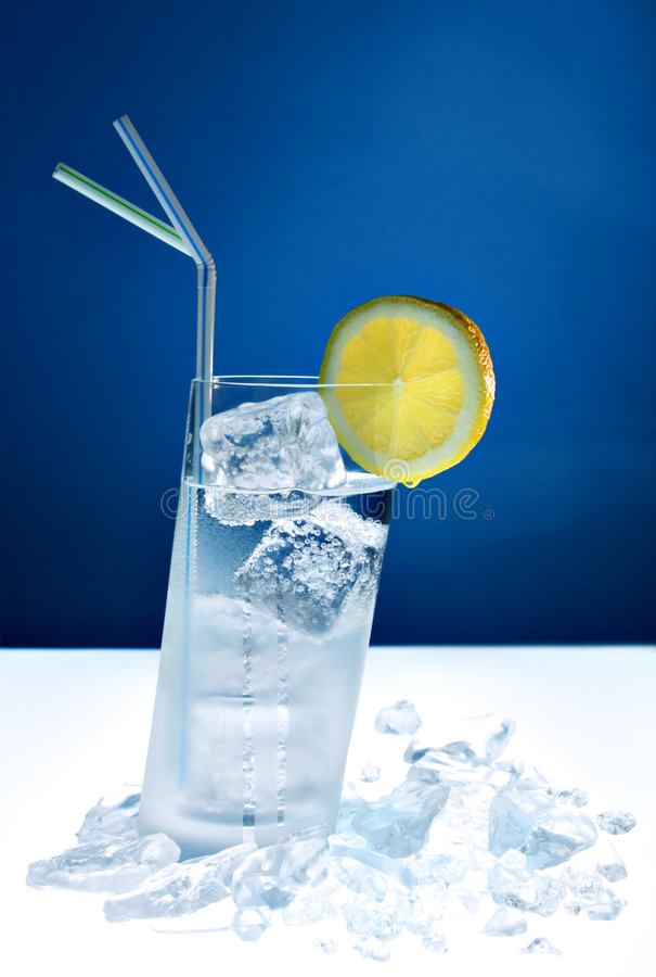 Chilled longdrink in slanted glass royalty free stock images