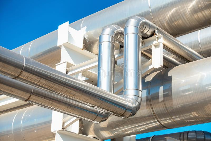 Chiller or Steam Pipeline and Insulation of Manufacturing in Oil and Gas Industrial, Petrochemical Distribution Pipe at Refinery. Plant. Overhead Steel Pipe stock image