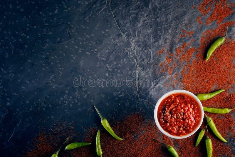 Chilli and garlic relish on dark slate. Chilli and garlic relish on black slate background from above royalty free stock photo