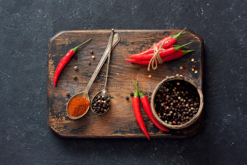 Chilli peppers and assorted dry peppers royalty free stock photos