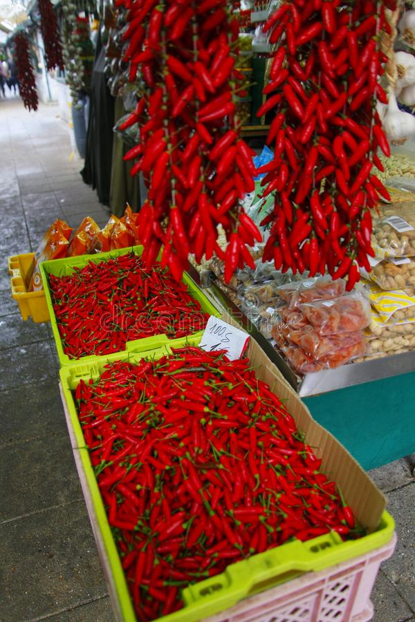 Chilli peppers stand at marked royalty free stock photo