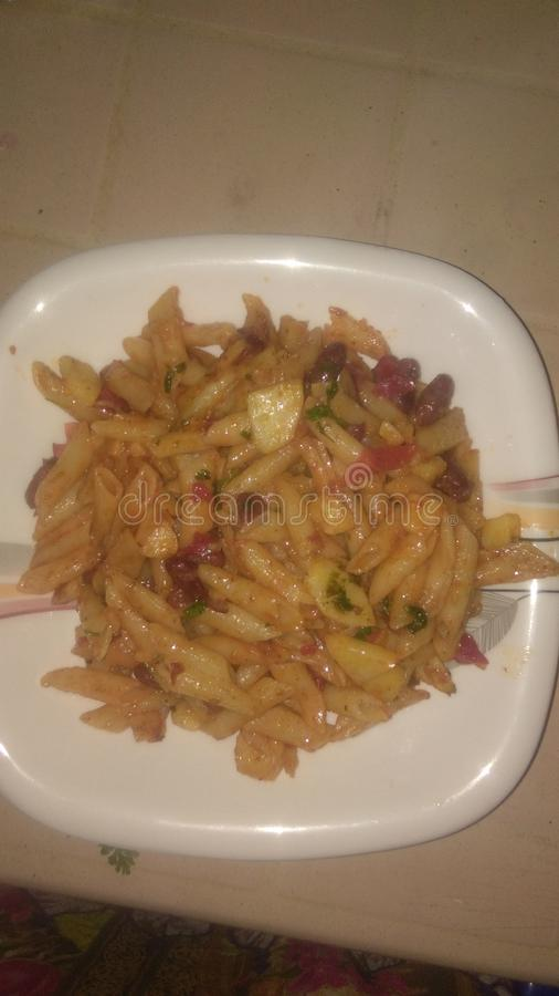 Chilli sause pasta stock images