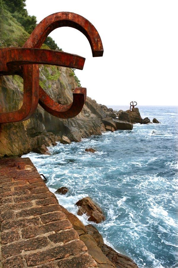 Chillida rusty steel sculpture in San Sebastian royalty free stock photography