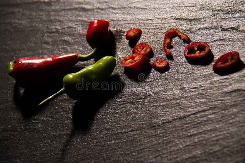 Chillies i ciapanie zdjęcia stock