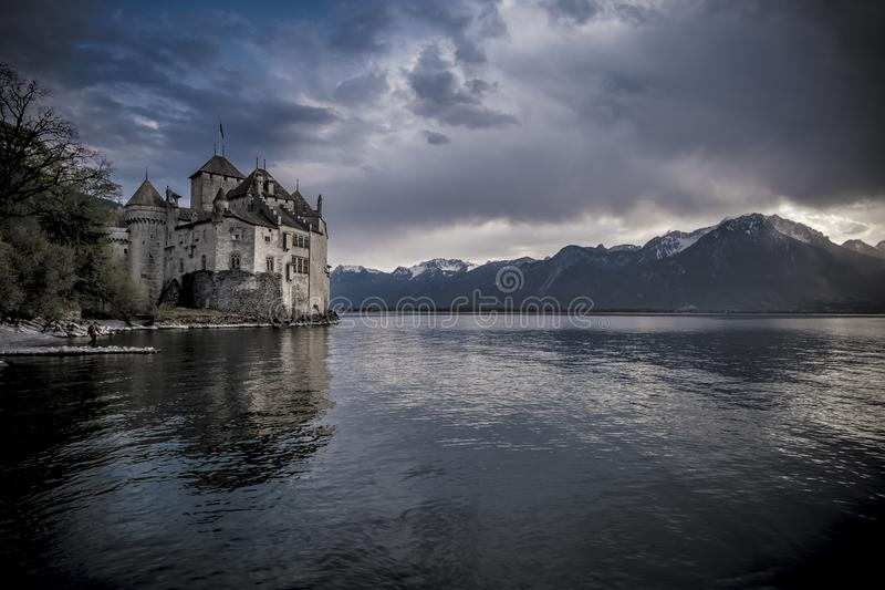 Sunset at Chillon Castle on the shores of Lake Geneva. Chillon Castle on the shores of Lake Geneva at dramatic sunset stock photos