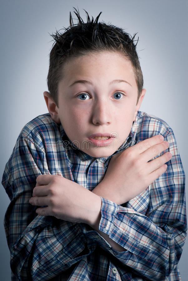 Chilly. Child with an expression of chilly royalty free stock images