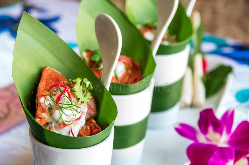 Chilly curry in banana leaf dessert packages stock images