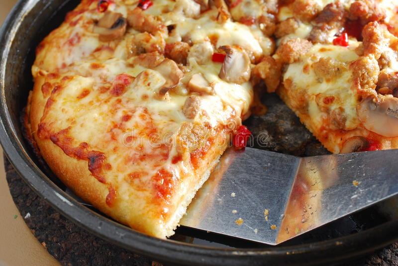 Chilly pizza slice in pan. Baked chilly pizza slice in pan stock image