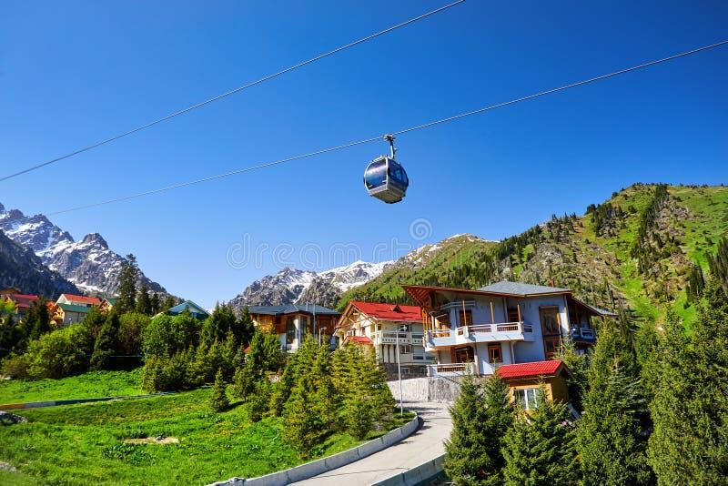 Chimbylak Ski Resort in Kazakhstan. Cable car and cottages in the mountain ski resort Chimbylak in Almaty, Kazakhstan royalty free stock photos