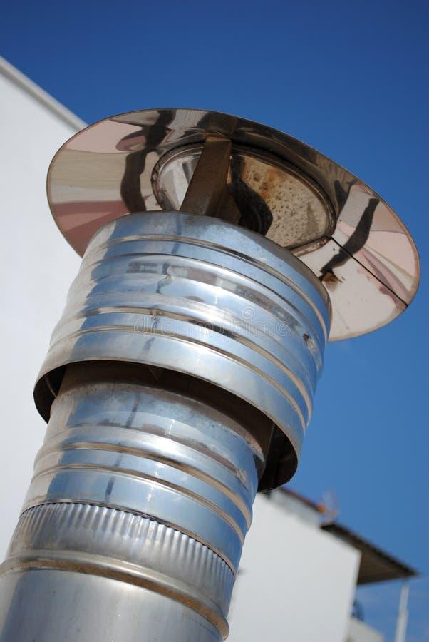 Chimney. Detail of metallic shiny chimney stock photo