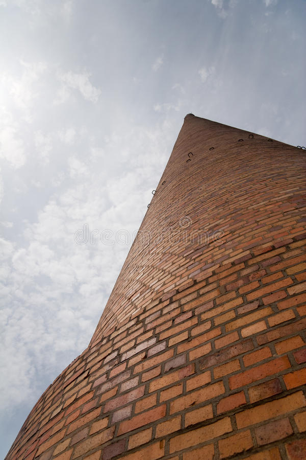 Chimney. A huge industrial chimney from the frog perspective stock photo
