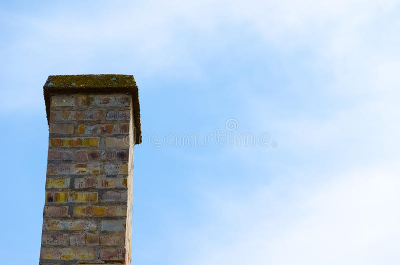 Chimney. Cloudy blue sky. Copy space for text. royalty free stock photo