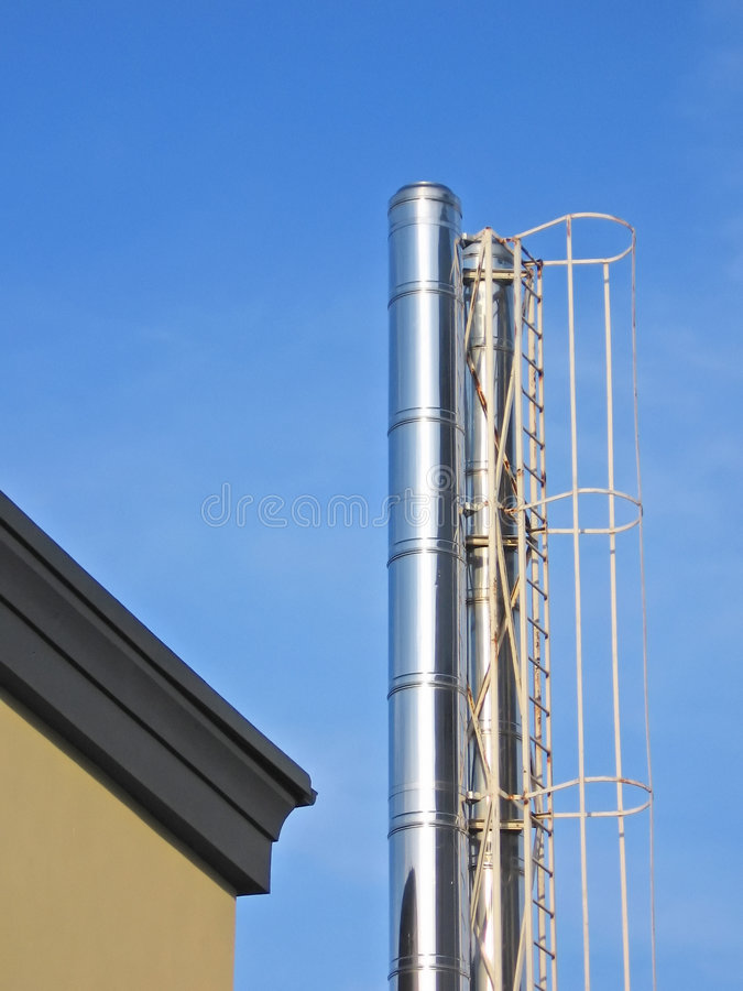 Chimney and ladder. Industrial chimney and ladder stock image