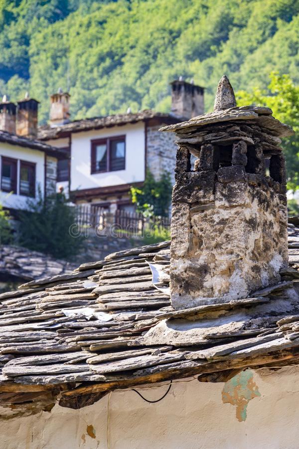 A chimney and other architectural details from old Bulgarian traditional revival style houses at the mountain village of Kosovo, B. Old traditional Rhodope royalty free stock image