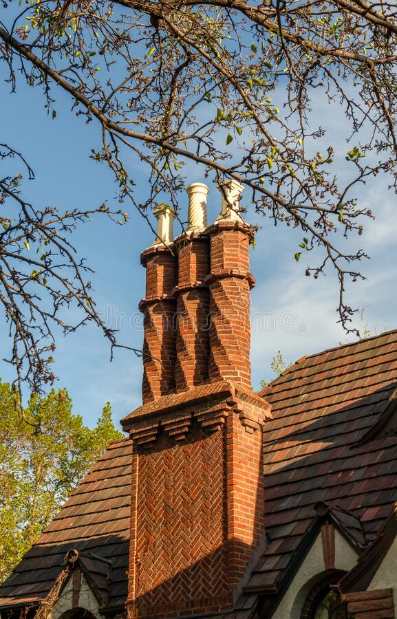 Chimney pots on the old house roof building in the 6th street  historic district of Denver royalty free stock image
