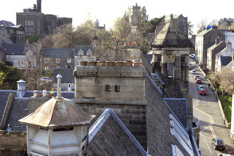 Chimney pots in a row. Stirling, Scotland has been inhabited for nearly a thousand years. Its medieval architecture spans many centuries and styles royalty free stock images