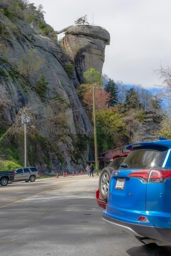 Chimney Rock State Park Parking Lot. Chimney Rock, North Carolina/USA - April 16 2018 - Tourist visit the rock formation called, `Chimney Rock` in Chimney Rock stock images