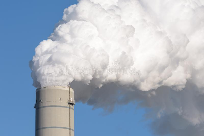 Chimney with smokestack of a coal power plant stock image