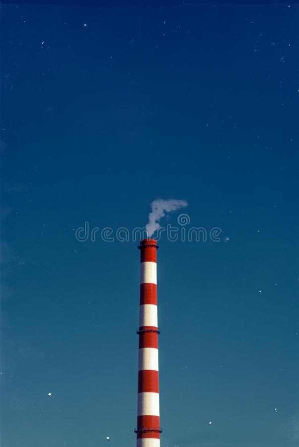 White and Red Factory Chimney Night. A chimney is a structure that provides ventilation for hot flue gases or smoke from a boiler, stove, furnace or fireplace to royalty free stock photography