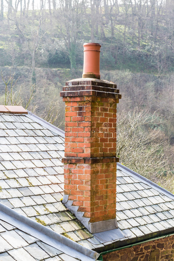 Chimney Top. A chimney on top of a slate roof stock photography